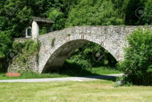 Old roman bridge at Lottigna on Blenio valley on Swiss alps